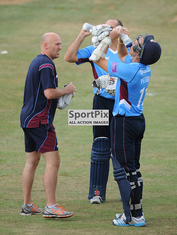 Northants Batsman take on a quick water drink, during their innings with New Zealand, Northants v New Zealand, Black Caps, County Ground, Northampton, 31st July 2014