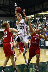 18 March 2011: Olivia Lett makes a mid-air pass when double teamed by Schaeperkoetter and Bethanny Morrison during an NCAA Womens basketball game between the Washington University Bears and the Illinois Wesleyan Titans at Shirk Center in Bloomington Illinois.