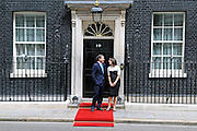 British Prime Minister David Cameron and his wife Samantha wait to welcome President Sarkozy of France and his wife Carla Bruni to Downing Street for Lunch on 18th June 2010. © under license to London News Pictures.