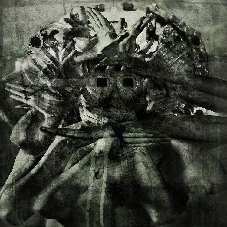 A conceptual image using hands, arms and square eyes