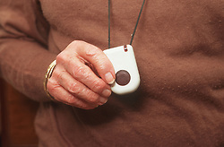 Close up of alarm pendant used by elderly people which provides immediate contact with call centre in the event of an emergency,