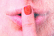 silence gesture extreme close up from a magazine print with halftone print dots