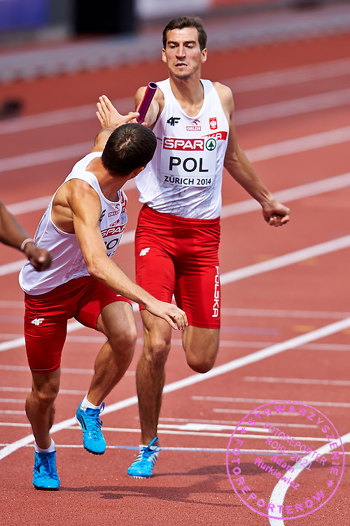 (L) Kacper Kozlowski and (R) Rafal Omelko both from Poland compete in Men's Relay 4 x 400 meters final during the Sixth Day of the European Athletics Championships Zurich 2014 at Letzigrund Stadium in Zurich, Switzerland.<br /> <br /> Switzerland, Zurich, August 17, 2014<br /> <br /> Picture also available in RAW (NEF) or TIFF format on special request.<br /> <br /> For editorial use only. Any commercial or promotional use requires permission.<br /> <br /> Photo by &copy; Adam Nurkiewicz / Mediasport