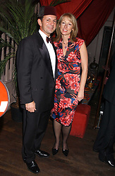 CHRISTOPHER & ALISON BANKS at a party to celebrate the recent merger of Chelsea Mortgage Management with Cobalt Capital - A Night in Marrakesh held at Raffles, nightclub, Kings Road, London on 1st December 2005.<br />