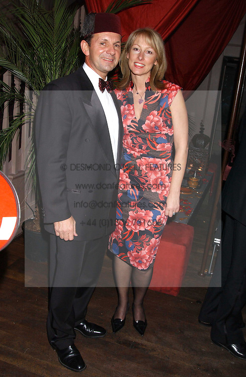 CHRISTOPHER & ALISON BANKS at a party to celebrate the recent merger of Chelsea Mortgage Management with Cobalt Capital - A Night in Marrakesh held at Raffles, nightclub, Kings Road, London on 1st December 2005.<br /><br />NON EXCLUSIVE - WORLD RIGHTS