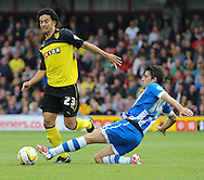 Picture by David Horn/Focus Images Ltd +44 7545 970036<br /> 28/09/2013<br /> Iriney of Watford and Jordi Gomez of Wigan Athletic during the Sky Bet Championship match at Vicarage Road, Watford.