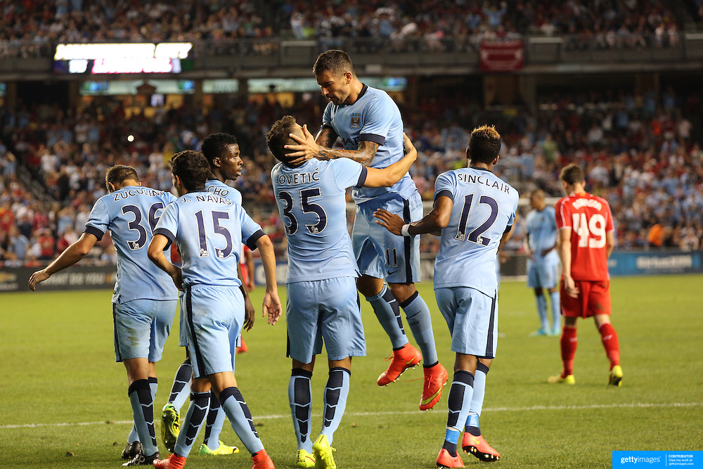 Stevan Jovetic, Manchester City, is congratulated by team mate Aleksandar Kolarov after scoring his sides second goal during the Manchester City Vs Liverpool FC Guinness International Champions Cup match at Yankee Stadium, The Bronx, New York, USA. 30th July 2014. Photo Tim Clayton