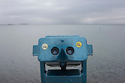 A 50p a go telescope looking out to the Thames estuary, on the Western Esplanade at Southend.