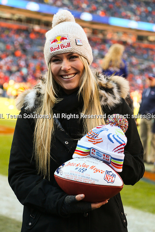 28 December 2014: Lindsey Vonn was on hand to present the game ball.  Denver Broncos defeated the Oakland Raiders by a score of 47 to 14 at Sports Authority Field at Mile High, Denver, CO.