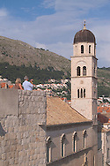 Tourists taking photographs of Dubrovnik<br /> from the city wall.  Dubrovnik, Croatia<br /> c. Ellen Rooney