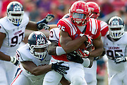 DALLAS, TX - NOVEMBER 16: K.C. Nlemchi #25 of the SMU Mustangs is tackled by Yawin Smallwood #33 of the Connecticut Huskies on November 16, 2013 at Gerald J. Ford Stadium in Dallas, Texas.  (Photo by Cooper Neill/Getty Images) *** Local Caption *** K.C. Nlemchi; Yawin Smallwood