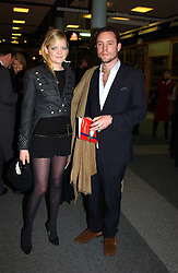 LADY ELOISE ANSON and MR SIMON BOUDARD at the Macmillan Cancer Relief Celebrity Christmas Stocking Auction held at Christie's, South Kensington, London on 8th December 2004.<br />
