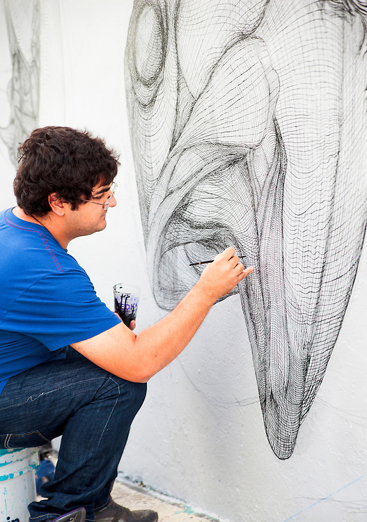 Artist paints mural in Miami's up and coming Wynwood arts district