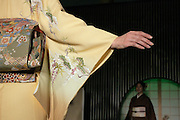 A model shows the sleeves of her kimono at a kimono fashion show in Kyoto