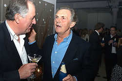 Left to right, JONATHAN AGNEW and LORD HINDLIP at an exhibition of work by Rolf Sachs - a unique world-renowned contemporary furniture designer, held in association with the Louisa Guinness Gallery and held at 250 Brompron Road, London on 6th October 2004.<br />
