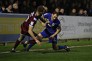 Port Vale midfielder Sam Kelly (7) and AFC Wimbledon defender & captain Barry Fuller (2) battle for possession during the EFL Sky Bet League 1 match between AFC Wimbledon and Port Vale at the Cherry Red Records Stadium, Kingston, England on 17 December 2016. Photo by Stuart Butcher.