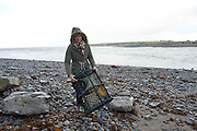 07/01/2014 Martina Sweeney from New Quay retrieving lobster pots from the shore around Aughinish. Photo:Andrew Downes