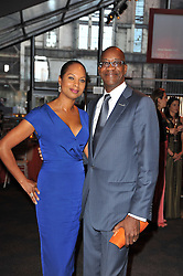 Olympic Games great EDWIN MOSES and his wife MICHELLE STRANIS at a gala evening in aid of Ubuntu Education Fund held at Battersea Power Station, London on 4th May 2011.