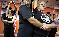 (CH) FL-el-argentinean-tango-CHf --Oscar Caballero, The Tango Times Dance Company's dance company director, and Roxana Garber are dancing during the practice of The Argentine Folk and Tango Show, at their studio in North Miami Beach on June 30, 2012. Saff photo/Cristobal Herrera Sun-Sentinel
