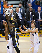 Golden State Warriors forward Draymond Green (23) takes the ball to the basket against the Dallas Mavericks at Oracle Arena in Oakland, California, on February 8, 2018. (Stan Olszewski/Special to S.F. Examiner)