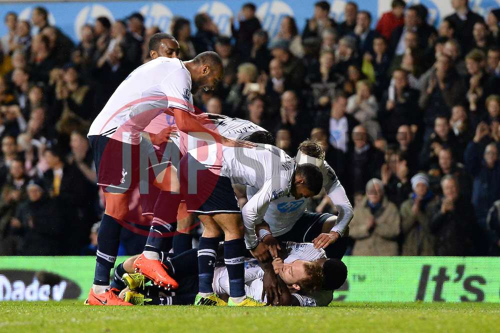 Tottenham's midfielder Christian Eriksen gets mobbed by team mates after scoring a goal  - Photo mandatory by-line: Mitchell Gunn/JMP - Tel: Mobile: 07966 386802 07/04/2014 - SPORT - FOOTBALL - White Hart Lane - London - Tottenham Hotspur v Sunderland - Premier League