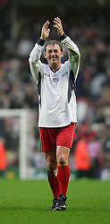 LIVERPOOL, ENGLAND - SUNDAY MARCH 27th 2005: Liverpool Legends' Kenny Dalglish applauds the fans after beating the Celebrity XI during the Tsunami Soccer Aid match at Anfield. (Pic by David Rawcliffe/Propaganda)