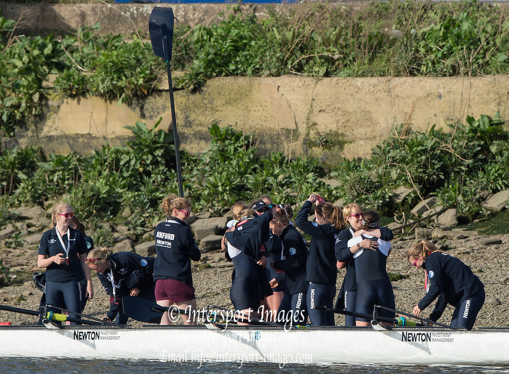 London, Great Britain, The women's Blue Boat crew are greeted by the Osiris crew after The Newton Women's Boat Race,  , Championship Course.  River Thames. Putney to Mortlake. ENGLAND. <br /> <br /> 17:13:19  Saturday  11/04/2015<br /> <br /> [Mandatory Credit; Peter Spurrier/Intersport-images]<br /> <br /> OUWBC Crew: <br /> Maxie SCHESKE, Anastasia CHITTY, Shelley PEARSON, Lauren KEDAR, Maddy BADCOTT, Emily REYNOLDS, Nadine GRAEDEL IBERG, Caryn DAVIES and Cox Jennifer EHR