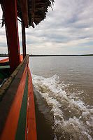 LORETO, PERU - CIRCA OCTOBER 2015:  Local motorboat in the Ucayali river in the Peruvian Amazon.
