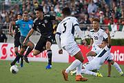 Mexico striker Raul Jiménez (9) dribbles past Cuban defenders Dariel Morejon (5),Yasmani Lopez (4) and Cuba midfielder Luismel Morris (20) during a game between Mexico and Cuba in a CONCACAF Gold Cup soccer match in Pasadena, Calif., Saturday, June 15, 2019. Mexico defeated Cuba 7-0. (Ed Ruvalcaba/Image of Sport)
