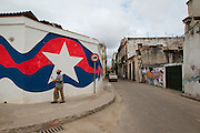 Cuba's national colors are painted along a wall in Old Havana.