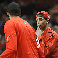 16 March 2012: French basketball player and slam dunk expert Guy Dupuy talks to Portland Trail Blazers small forward Nicolas Batum (88) prior to the Portland Trail Blazers 100-89 victory over the Chicago Bulls at the United Center, Chicago, Illinois, USA.