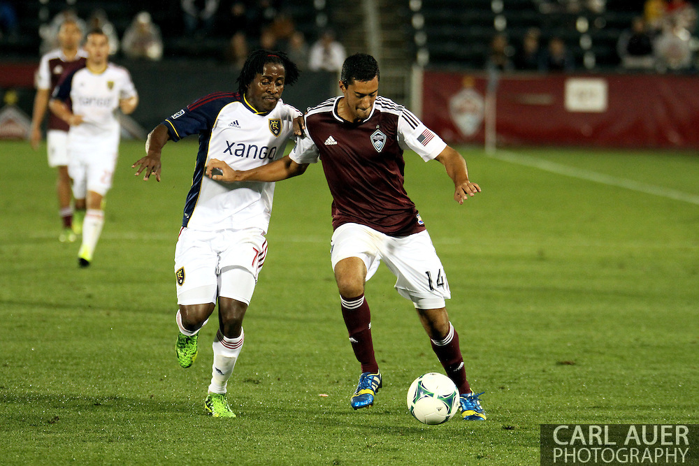 August 3rd, 2013 - Colorado Rapids midfielder Tony Cascio (14) attempts to keep the ball from Real Salt Lake midfielder Lovel Palmer (7) in the second half of the Major League Soccer match between Real Salt Lake and the Colorado Rapids at Dick's Sporting Goods Park in Commerce City, CO