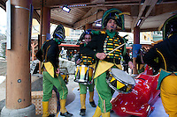 A band from Jamaica dresses in the country's colors to show support for the one Olympic athlete, freestyle skier Errol Kerr, in the 2010 Olympic Winter Games in Whistler, BC Canada