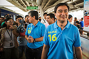 16 FEBRUARY 2013 - BANGKOK, THAILAND: ABHISIT VEJJAJIVA, former Prime Minister of Thailand, walks through the MoChit BTS station while campaigning for his party colleague Sukhumbhand Paribatra ahead of Bangkok's governor election. Bangkok residents go to the polls on March 3 to elect a new governor. Sukhumbhand Paribatra, the current governor, is running on the Democrat's ticket and is getting help from national politicians like Abhisit Vejjajiva, the former Thai Prime Minister. One of Sukhumbhand's campaign pledges is to improve Bangkok's mass transit and transportation system. Abhisist road the BTS Skytrain to campaign for Sukhumbhand.      PHOTO BY JACK KURTZ