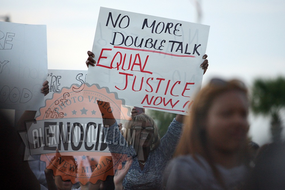 Supporters hold signs up during a rally for the shooting of Trayvon Martin on Thursday, March 22, 2012 at Fort Mellon Park in Sanford, Florida. (AP Photo/Alex Menendez) Trayvon Martin rally in Sanford, Florida.