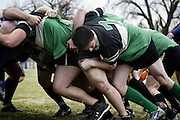 A herd of Grinnell Griffon rugby players churn their legs during a scrum on MacEchron Field in Grinnell during their recent game against the River City Rugby football club of Mason City.