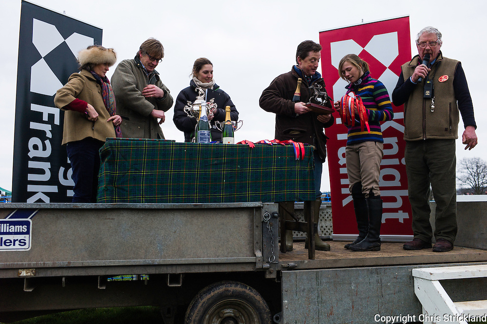 Winning jockey Joanna Walton is presented with her prizes by sponsors Knight Frank.