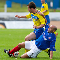 Cowdenbeath v St Johnstone....21.07.12  pre-season friendly<br /> Colin Cameron tackles Kevin Moon<br /> Picture by Graeme Hart.<br /> Copyright Perthshire Picture Agency<br /> Tel: 01738 623350  Mobile: 07990 594431
