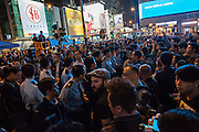 Police form a line keeping opposing groups of protesters apart during a moment of tension. Protesters known as the Umbrella Revolution or Occupy Mongkok, an extension of the larger Occupy Central movement, have taken over a number of blocks on the busy road and staged an ongoing demonstration calling for universal suffrage for Hong Kong.