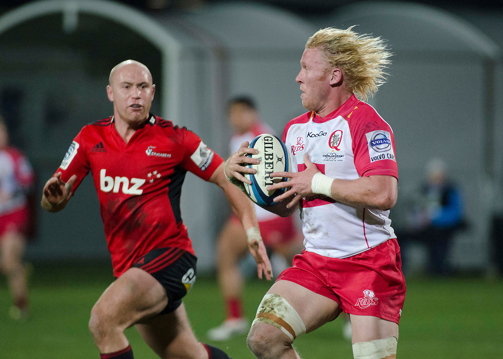 Reds  Beau Robinson makes a break against the Crusaders in the Super Rugby qualifier match at AMI Stadium, Christchurch, New Zealand, Saturday, July 20, 2013. Credit:SNPA / David Alexander