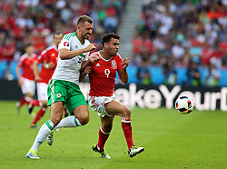 PARIS, FRANCE - Saturday, June 25, 2016: Wales' Hal Robson-Kanu in action against Northern Ireland's Gareth McAuley during the Round of 16 UEFA Euro 2016 Championship match at the Parc des Princes. (Pic by David Rawcliffe/Propaganda)