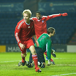 LEICESTER, ENGLAND - Tuesday, January 12, 2010: Liverpool's Lauri Dalla Valle celebrates scoring the second of his first half hat-trick goals past Leicester City's goalkeeper Robert Ambrusics during the FA Youth Cup 4th Round match at the Walkers Stadium. (Photo by David Rawcliffe/Propaganda)