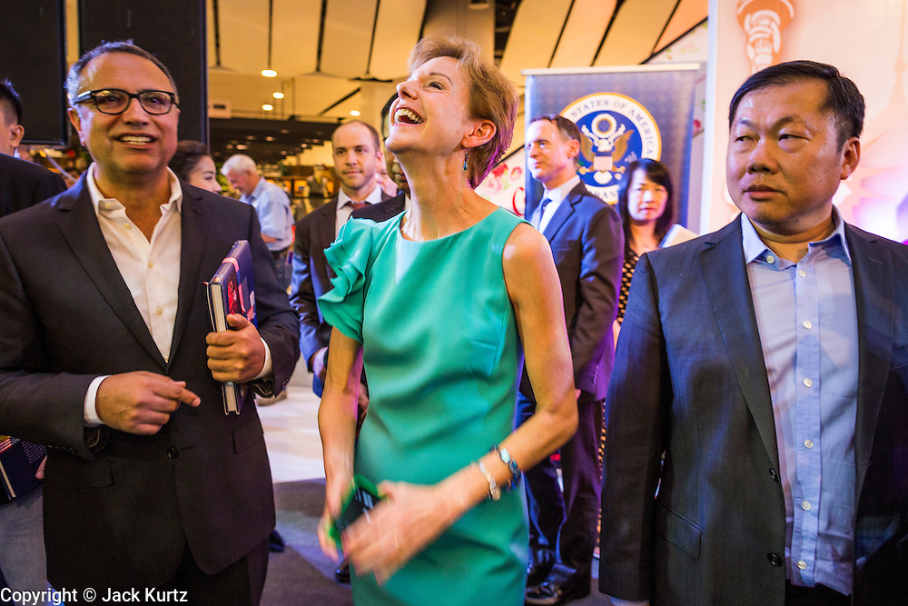 19 JULY 2013 - BANGKOK, THAILAND:   KRISTIE KENNEY, the US Ambassador to Thailand, laughs at a joke at the opening of a photo exhibit sponsored by the US Embassy in Bangkok. The photo exhibit celebrates 180 years of US-Thai diplomatic relations. There are 180 photos hanging in the show, 90 by American photographers in Thailand and 90 by Thai photographers in the United States. The show, which opened July 19, is hanging in CentralWorld, a large mall in Bangkok, and is touring Thailand when it concludes its Bangkok run on July 21.   PHOTO BY JACK KURTZ