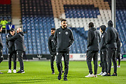 Brentford players inspect the pitch ahead of the EFL Sky Bet Championship match between Queens Park Rangers and Brentford at the Kiyan Prince Foundation Stadium, London, England on 28 October 2019.