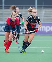 AMSTELVEEN  - Melanie van Rijn (Adam) met Lisanne de Lange (Laren)  tijdens de hoofdklasse competitiewedstrijd hockey dames , Amsterdam-Laren (3-0)  , COPYRIGHT KOEN SUYK