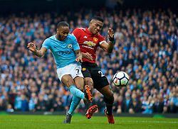 MANCHESTER, ENGLAND - Saturday, April 7, 2018: Manchester City's Raheem Sterling and Manchester United's Antonio Valencia during the FA Premier League match between Manchester City FC and Manchester United FC at the City of Manchester Stadium. (Pic by David Rawcliffe/Propaganda)