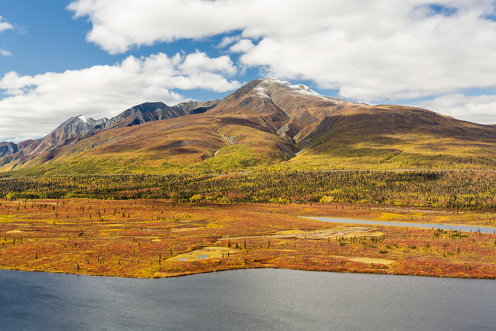 Autumn colors highlight Knob Lake and Gunsight Mountain along the Matanuska Valley and the Glenn Highway in Southcentral Alaska. Afternoon.