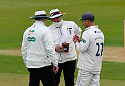 Ryan ten Doeschate talks to the umpires as he is unhappy with the ball and has it changed during the first day of the Specsavers County Champ Div 1 match between Hampshire County Cricket Club and Essex County Cricket Club at the Ageas Bowl, Southampton, United Kingdom on 5 April 2019.