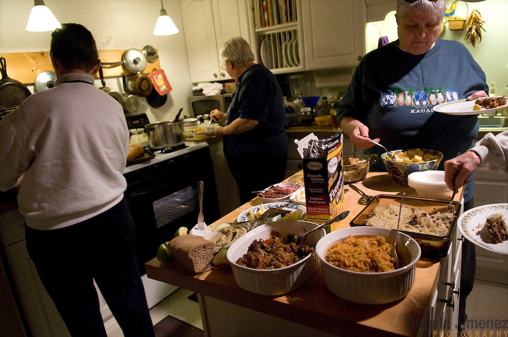 "Date: 1/08/09.Desk: STL.Slug: WOMYN.Assign ID: 30074969A..Women gather for a potluck dinner at Alapine, a ""womyn's land"" or lesbian intentional community, in rural northeast Alabama. Pictured are, from left, Jean Adele, 72, Mary, 63, (*her last name cannot be used), and Barbara Moore, 63. The potluck was held in the home Mary shares with her long-time partner.  ..(*the exact town/location of the community cannot be revealed in the caption or article, per agreement with the subjects)..Photo by Angela Jimenez for The New York Times .photographer contact 917-586-0916."