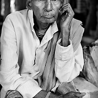 An under-nourished man waits in line outside the out-patients clinic at the JSS hospital in Ganiyari. The out-patient clinics at the JSS hospital are over subscribed. Many patiens will wait two or three days before being seen by a doctor. <br />